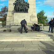 A Canadian soldier who was shot outside the war memorial on Parliament Hill in tended to in Ottawa on Wednesday.