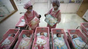 Nurses check on newborns in the Hello Kitty-designed maternity ward at the Hau Sheng Hospital in Taiwan in 2009.