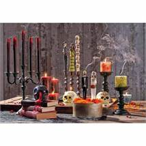 LOS MUERTOS AND BLEEDING CANDLES