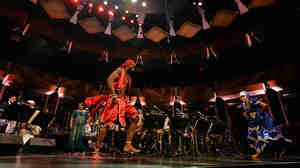 Dreiser Durruthy Bambolé (left) and Yesenia Fernandez Selier dance in front of the Jazz at Lincoln Center Orchestra.