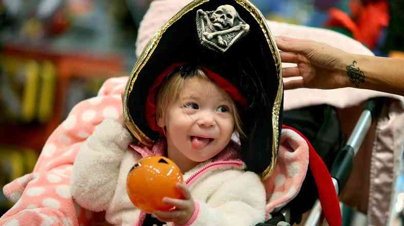 Candice Nelson fits her daughter Arya Kubesh with a Halloween hat at a store at Galleria Mall in Edina, Minn. Retailers are hoping Halloween will give them a good bounce into the peak spending time of the year.