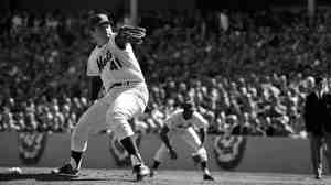 Tom Seaver of the New York Mets pitches in the fourth game of the 1969 World Series.