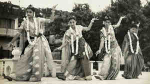 The author's mother, Reba Roy (far left), dancing on stage in a sari as a young woman.