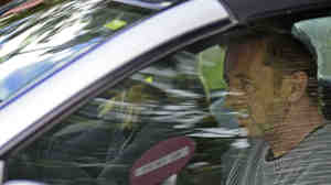 Phil Rudd, the drummer for rock band AC/DC, leaves a court house in Tauranga, New Zealand, on Thursday.