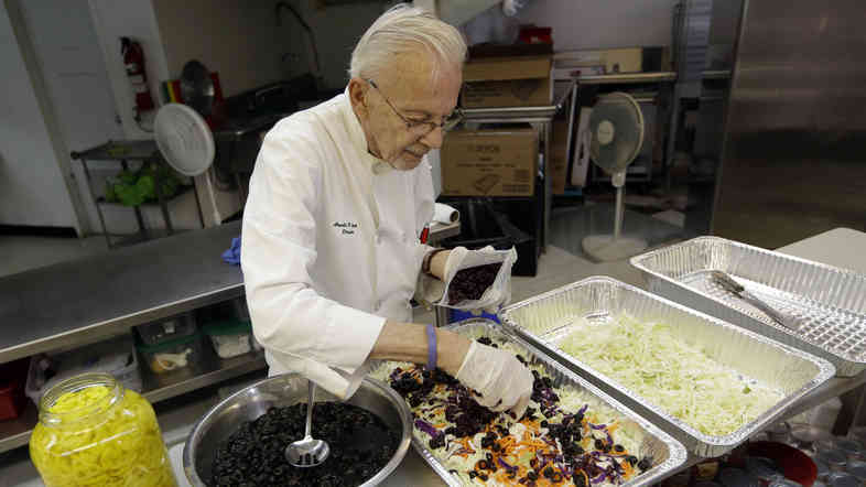 Homeless advocate Arnold Abbott, 90, director of the nonprofit group Love Thy Neighbor Inc., prepares a salad in the kitchen of The Sanctuary Church, Wednesday, Nov. 5, 2014, in Fort Lauderdale, Fla. Abbott was recently arrested,  along with two pastors, for feeding the homeless in a Fort Lauderdale park.