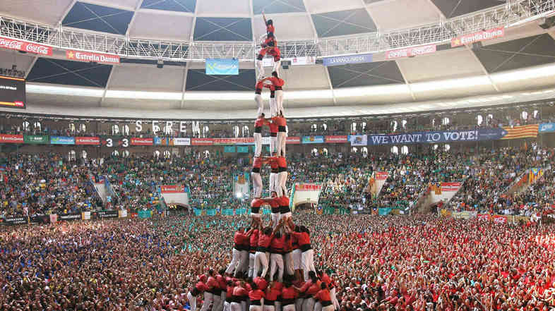 The runner-up team performs in the 25th castells competition at Tarraco Arena ring in Tarragona, Catalonia, northeastern Spain, on Oct. 5.