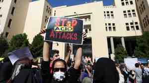 "Iranians protest in Isfahan, Iran, last month in solidarity with women injured in a series of acid attacks. Several women have been attacked by assailants on motorcycles who threw acid on their faces, purportedly because they were ""badly veiled."""