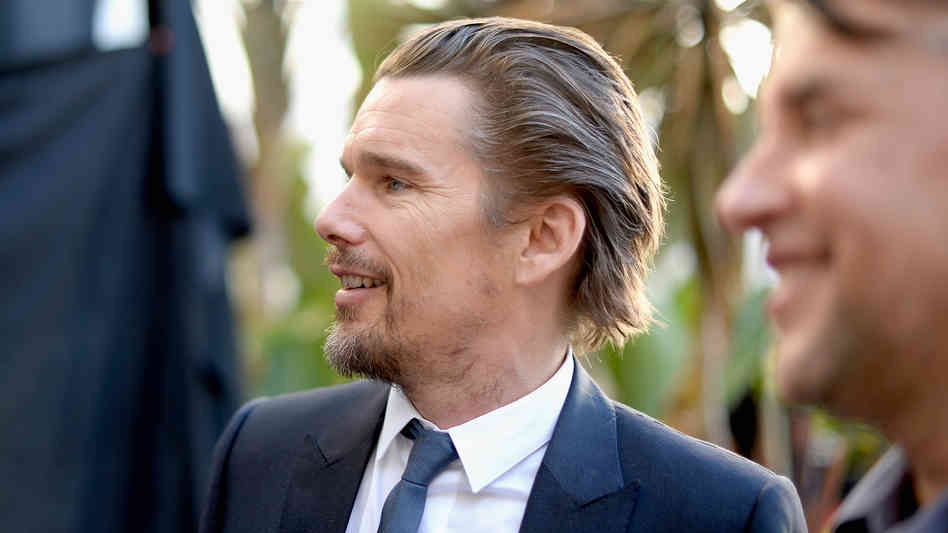 Ethan Hawke (with director Richard Linklater) at the 86th Academy Awards nominees luncheon.