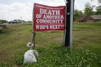 A sign on a Bayou Corne resident's lawn near the sinkhole