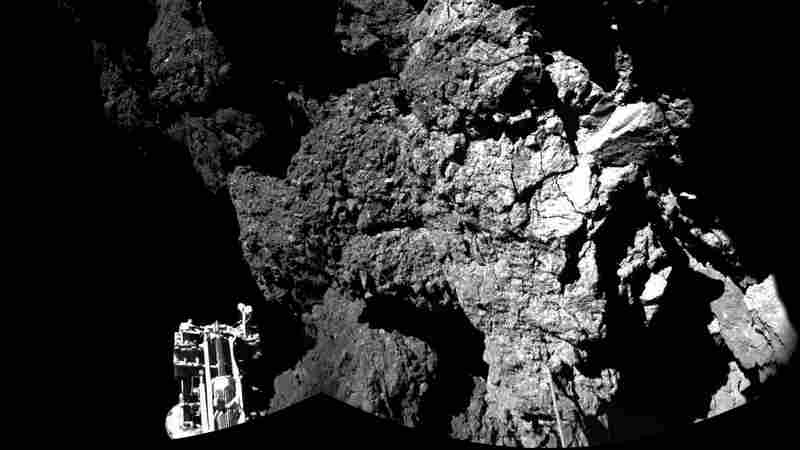The Philae lander beamed back images showing one of its three feet on the surface of Comet 67P/Churyumov-Gerasimenko . This photo is compiled from two images; a wider version will be released later Thursday.