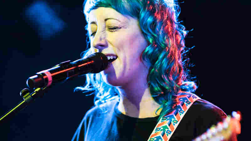 Cayetana's Augusta Koch stands center stage at NPR Music's show during the CMJ Music Marathon.