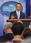 U.S. President Barack Obama pauses as he speaks on the Affordable Care Act in the Brady Press Briefing Room of the White House on November 14, 2013 in Washington, D.C.