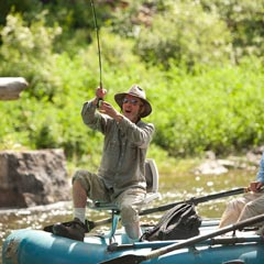 photo of man fishing from raft on Smith River.