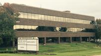 Booming insurer buys another office building