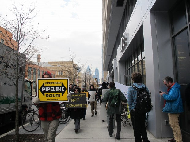 "Dozens of protestors carried signs and chanted ""no fracking hub"" outside Drexel University's Creese Student Center where business leaders met to discuss plans for expanding Philadelphia's role in the Marcellus Shale natural gas boom."