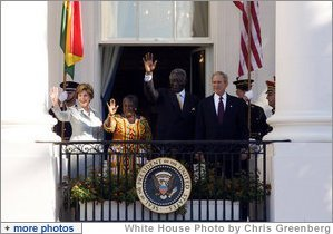 President George W. Bush and Mrs. Laura Bush, joined by President John Agyekum Kufuor and Mrs. Theresa Kufuor of Ghana, acknowledge the crowd Monday, Sept. 15, 2008, following the South Lawn Arrival Ceremony for President Kufuor and Mrs. Kufuor of Ghana at the White House. White House photo by Chris Greenberg