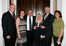 Pictured are David Wennergren, Amy Harding, Paul Bartock, Ricki Vanetesse, Ken Heitkamp, and Karen Evans.