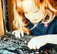 Child playing near peeling paint