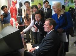 May 13, 2008 – U.S. Secretary of Health and Human Services (HHS) Michael O. Leavitt (right) and Josephine Briggs, M.D., the Director of the National Center for Complementary and Alternative Medicine of the HHS National Institutes of Health (left), receive a lesson in acupunture techniques from a student at the Shanghai University of Traditional Chinese Medicine, in Shanghai, China. (Photo Credit: Bill Steiger, HHS)