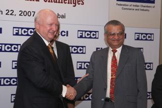 Secretary Bodman and Indian Atomic Energy Secretary, Dr. Kakodkar, shake hands
