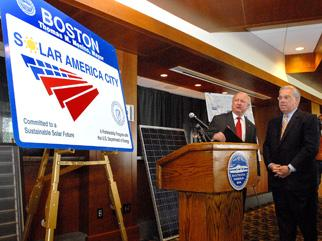 Secretary Bodman presents the mayor of Boston with a road sign denoting it as one of DOE's Solar America Cities
