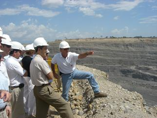 A Colombian Mine Tour Guide Points Out Highlights of the Mine to Acting Deputy Secretary Kupfer and Others on a Edge of a cliff