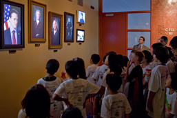 Children from Camp Invention watch the USPTO Museum's Portrait Gallery Video Exhibit at it's opening last week
