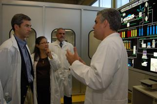 Deputy Secretary Kupfer listens to a scientist explain the ongoing research and development of biofuels at the Petrobras' Leopoldo Americo Miquez de Mello Research and Development Center (CENPES).