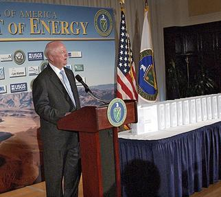 Secretary Bodman speaks at the National Press Club, next to a table with an 8,600 page license application