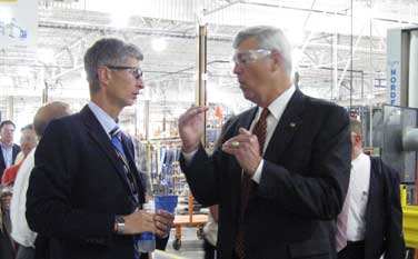 U.S. Commerce Assistant Secretary William G. Sutton (right) leads the second Sustainable Manufacturing American Regional Tour (SMART) at Steelcase, Inc., a Michigan-based wood products manufacturer.