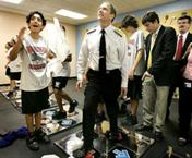 Acting Surgeon General Steven K. Galson joins students in a game at Nautilus Middle School in the wellness center.