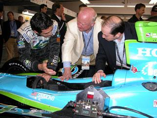 Secretary Bodman and Assistant Energy Secretary Andy Karsner view the workings of an Indy race car