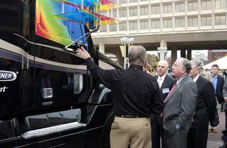 Deputy Assistant Secretary Rodgers, Congressman Hobson and Robert Clark review new trucks