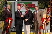 Energy Secretary Samuel Bodman and Maryland Governor Robert Ehrlich shake hands at the opening of Maryland's first State-owned E-85 fueling facility.