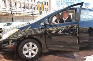 A123Systems' President Vieau shows Secretary Bodman their plug in hybrid conversion vehicle