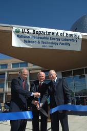 Secretary Bodman (middle) cuts the ribbon to officially open the DOE NREL's Science & Technology Facility