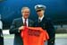President George W. Bush met U.S. Coast Guard Academy third class cadet Greg Ponzi upon arrival in New London, Connecticut, on Wednesday, May 21, 2003. Ponzi volunteers in the New London area and helps fellow cadets find volunteer opportunities.