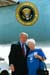 President George W. Bush met Ana Cooper upon arrival in Miami, Florida, on Monday, June 30, 2003. Cooper volunteers 20 hours each week through the Senior Companion program, offering assistance to older Americans in the Miami community.
