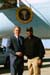 President George W. Bush met U.S. Navy Senior Chief Arden Battle upon arrival in Jacksonville, Florida, on Thursday, February 13, 2003. Battle, currently assigned to the USS John F. Kennedy, volunteers approximately 20 hours each month helping community organizations.