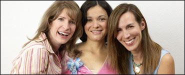 Photo: Three smiling women.
