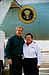 President George W. Bush met Suellen Mayberry upon arrival in San Diego, California, on Tuesday, November 4, 2003. Mayberry, an active volunteer with the American Red Cross, helped establish and relocate an emergency shelter for individuals and families forced to evacuate their homes due to recent California wildfires.