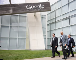 Secretary Michael Chertoff walks outside the Google Office Building