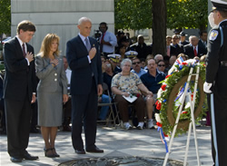 Acting Attorney General, Peter Keisler; Martha Wood, Law Enforcement Survivors Representative; Secretary Chertoff standing before the wreath at the 16th annual wreathlaying ceremony. (DHS Photo/Bahler)