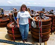 Teacher at Sea Jennifer Richards stands in front of buoys