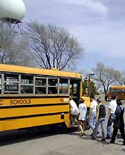 Children board the schoolbus after touring one of NOAA's research laboratories
