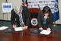 Assitant Security Julie Myers and Puerto Rico's Secretary of Correction and Rehabilitation, Miguel Pereira, signing a partnership agreement that will assist in ensuring that aliens serving criminal sentences are identified and processed for removal prior to their release from state custody