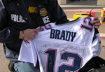 ICE Enforcers examine football jersey.