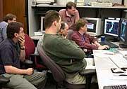 NSSL Spring Experiment participants study the radar displays