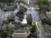 Homes in this neighborhood are surrounded by flood water.