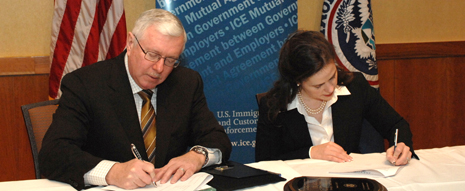 AS Julie Myers signing agreement